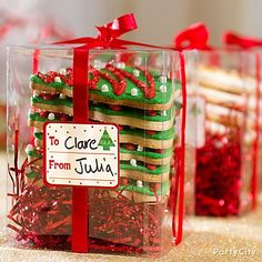 Clear gift boxes are a festive idea for cookie exchange parties! Get more tips for a baking up a sweet cookie exchange party -- just click the pic.