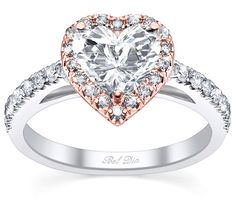 Heart shaped rose gold engagement ring with rose hold halo.  This romantic ring is exclusively available from Debebians.