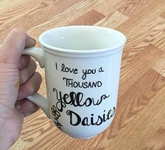 Gilmore Girls mug. I love you a Thousand Yellow Daisies. Ceramic or Porcelain mug with Gilmore Girls coffee quote. I love you a Thousand Yellow Daisies. Quote is hand drawn on, then sealed and baked for durability. You pick the style and size of mug. Mug is designed to be top rack Dishwasher safe, HOWEVER as each dishwasher is different, **I Cannot guarantee your mug safety in the dishwasher.** So I Highly recommend *HAND WASH* gently only. (**Do not scrub or soak; air dry only**).