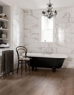 Designed to replicate the stunning white Calacatta marble found in Italy, this ceramic wall tile follows the bold white marble trend and exudes luxury. Perfect for a classic bathroom, compliment the intense grey veining with a warm wood effect tile on the floor.
