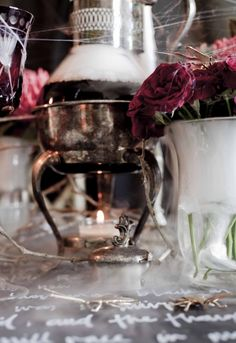 Halloween Addams Family Style!  Decanters + Red Roses + Dry Ice + Cobwebs  Styling & Staging By Pack A Perfect Party  Photography By Michael Williams