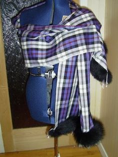 Pashmina in silk and cashmere  70/30 shown here in Mackenzie tartan [old colours]  ,  with fur trim ;only available from Exclusively Yours in Scotland.