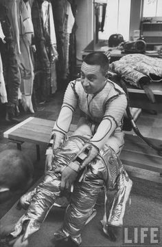 Astronaut Virgil Grissom putting on his pressure suit. Location: US Date taken: March 1960 Photographer: Ralph Morse