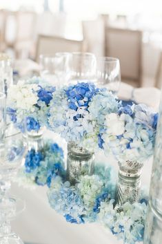 Blue and White Hydrangea, Mercury Glass Centerpieces | Charleston Stems https://www.theknot.com/marketplace/charleston-stems-charleston-sc-754448 | Luke Wilson | Corbin Gurkin Photography https://www.theknot.com/marketplace/corbin-gurkin-photography-charleston-sc-767241