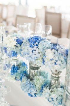 Blue and White Hydrangea, Mercury Glass Centerpieces   Charleston Stems https://www.theknot.com/marketplace/charleston-stems-charleston-sc-754448   Luke Wilson   Corbin Gurkin Photography https://www.theknot.com/marketplace/corbin-gurkin-photography-charleston-sc-767241