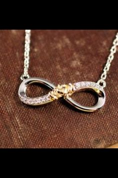 I would probably die of happiness if this was given to me, not only do I love the Infiniti sing and what it stands for I also love the cladaugh traditions and what they mean! <3