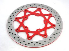 Powder coated motorcycle brake disc. See our gallery here: http://boneheadperformance.com/photo-gallery/