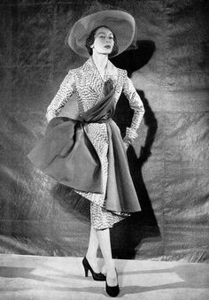 1951 Model in gray and white taffeta cocktail ensemble by Jacques Fath, photo by Jacques Decaux
