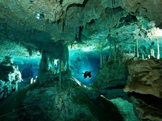 """This cavernous cenote with double entry points—hence the moniker """"Two Eyes""""—is so incredible it was featured in the IMAX film Journey Into Amazing Caves and an episode of Discovery Channel's Planet Earth. It's perfect for snorkelers, experienced scuba divers, and daredevils willing to surface in the system's bat cave."""