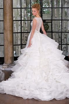 A beautiful mermaid wedding dress with a stunning ruffle train. Ines di Santo Fall 2015