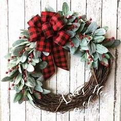 This wreath is a perfect edition to your Farmhouse Christmas decor. This wreath is made on an and grapevine form. It is made with faux lambs ear and berries. A buffalo check bow in black and red finish off this wreath for the perfect Farmhouse look Christmas Wreaths For Front Door, Christmas Door Decorations, Holiday Wreaths, Holiday Decor, Winter Wreaths, Spring Wreaths, Summer Wreath, Deco Mesh Christmas Wreaths Diy, Thanksgiving Wreaths
