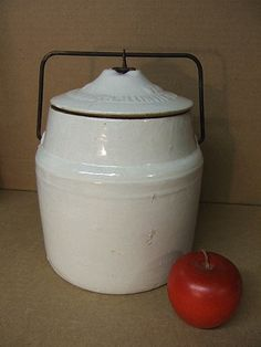 An antique stoneware canning jar.