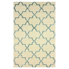 Wool and art silk rug with a quatrefoil-inspired trellis motif. Hand-tufted in India.   Product: RugConstruction Mate...