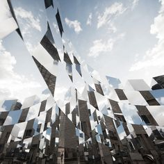 Arnaud Lapierre, Mirrored cubes installation, 2012. The ring installation distorts and reconstructs reality through the layering of reflections and voids.