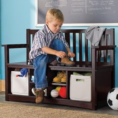 I love that it has storage bins for shoes and toys! Perfect for entry way