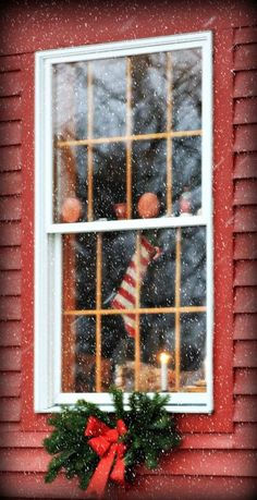 Window exterior at Christmas, red house with white trim