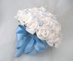 baby blue and sliver wedding flowers  | made from pale blue organza ribbon with a pale blue handle the posy ...