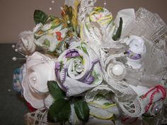 Nostalgic bridal bouquet featuring vintage handkerchiefs crafted into unique roses with other shabby chic treasures- my mom's creations!