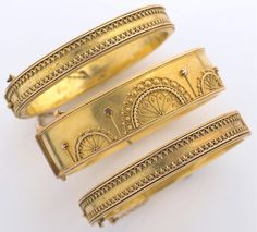 highvictoriana:  Three Victorian gold hinged bracelets in the Etruscan style.