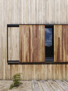 El Rancho Relaxo by Wolveridge Architects is a contemporary costal home in Melbourne that uses recycled timber, rammed earth, polished concrete and native vegetation