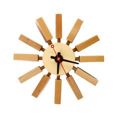Brighten up your timekeeping with this retro natural wood wall clock. Based on a classic 1950s design, mellow wood blocks extend from the clock face in rays to mark the hours and make a strong stylistic statement on your wall.