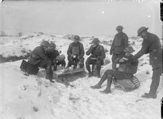 A group of South African officers having lunch in the snow, Beaumont Hamel, December Their 'table' is a trench howitzer bomb crate. World War One, First World, Beaumont Hamel, War Image, Ww2 Planes, North Africa, Photojournalism, Wwi, Armed Forces