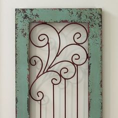 """$100. For above windows   Savannah Wall Panel Like a doorway to the past, it speaks of garden parties, laughter, ice melting in glasses. Unique and romantic painted wood panel is aged and fitted with a rusted iron screen. 14"""" x 49"""". No rush delivery. Ships to 48 contiguous states only. ($10.00 additional shipping)"""