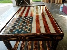 """x x 20 """" tall Wood Inlay American Flag Coffee Table with epoxy top (looks like glass) finish. The wood has a torched /distressed/ polyurethane finish with a bottom shelf. Unique Coffee Table, Diy Coffee Table, Coffee Table Design, Wooden American Flag, Wooden Flag, American Flag Decor, Metal Flag, American Country, Woodworking Furniture"""
