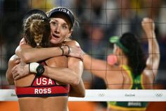 USA's Kerri Walsh Jennings (2L) and USA's April Ross react after losing the women's beach volleyball semi-final match between USA and Brazil at the Beach Volley Arena in Rio de Janeiro on August 16, 2016, as part of the Rio 2016 Olympic Games. / AFP / Leon NEAL (Photo credit should read LEON NEAL/AFP/Getty Images)