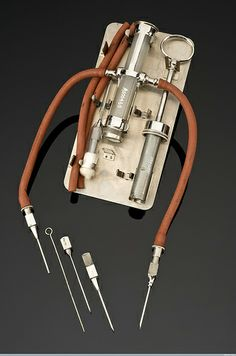 Credit: Science Museum, Wellcome Library, London. The double-ended blood transfusion apparatus meant that the recipient and donor of the blood could be hooked up to the same device. The whole process took thirty minutes. The apparatus was invented by Dr Louis Jubé, whose name is printed on the lid of the tin.