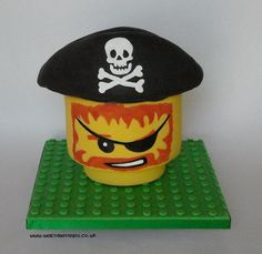 Pirate Lego Head Birthday Cake - Pirate Lego Head Birthday Cake (head chocolate cake with chocolate butter cream hat RKT).   This was for my Brother & Nephew whose birthdays are on the same day and who had recently stayed at the LEGOLAND Hotel (pirate room) xx