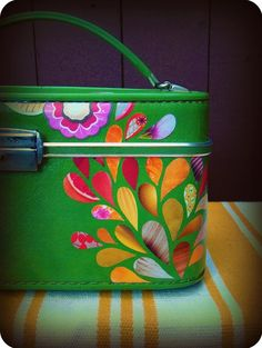 decoupage vintage luggage with pretty scraps of fabric/paper