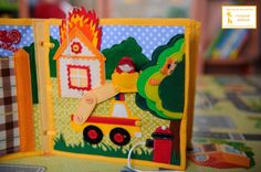 """Fire Station & House Fire Page - ring a bell Suddenly fire starts! Pull the string and there is a flame. But brave firefighter comes and starts putting out a fire! Fear kitten climbed a tree, but even here the brave rescuer helped! He climbed up on a lift and saved a kitten! on one part of the tree hive with bees (bees compare two"""" large - small """"), the second three apples, the third kitten)) The car wheels button on - Developmental book for Egorushka!"""