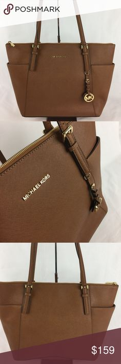 """Michael Kors Jet Set Leather East West Zip Tote Condition:  New, with tags. Light scratch on hardware from handling.   A multitude of pockets keeps you organized, while the top-zip design ensures your essentials stay put, wherever you may go. Saffiano Leather, 17""""W x 11""""H x 5""""D, 10"""" handle drop, top zip fastening, 1 padded pocket for small tablet, 2 open, 1 zipper pocket, 2 pockets on exterior.   Thank you for your interest! No Trades Please. Michael Kors Bags Totes"""