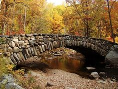 Boulder Bridge during autumn. Stop by the Nature Center and pick up a map before heading out on a hike through the Valley Trail.