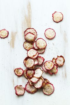 Radish Chips: 1/3 lb thinnly sliced radishes, 1 Tbsp olive oil, salt, fresh ground pepper // Heat oven to 300 // In a bowl combine all ingredients and mix well to coat thouroughly.  Arrange in single layer on baking tray - some overlap is okay.  Bake 30-40 minutes, rotate the tray halfway through bake, until radishes are dry and crispy. Be careful not to overbake - chips will crisp while cooling.