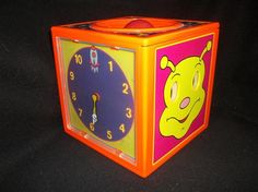 Bozart Toy Activity Cube – (VHTF Made 1998) Push the rocket ship down and the fun begins!! 10-9-8-7-6-5-4-3-2-1 Blast Off!! This exciting toy, with it's bright colors and mechanical sounds, will delight children while they practice counting FORWARDS and BACKWARDS!!
