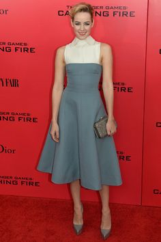Jena Malone in a Valentino dress and clutch and Casadei pumps at the Toronto Catching Fire premiere