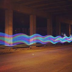 Colorful waves at night.  #grafittilights #longexposure #photography #rainbowcolors #running #waves #waterunderthebridge #underthebridge #night #DIY #tech