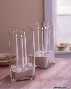 Sand Centerpiece - Sand Centerpiece Light up a table with this sand-and-shell centerpiece. Use candle adhesive to secure slender tapers to the bottom of a clear glass vase. Carefully pour in a few inches of sand, then arrange shells on top Non Floral Centerpieces, Summer Centerpieces, Baby Shower Centerpieces, Wedding Centerpieces, Wedding Decorations, Wedding Ideas, Flowerless Centerpieces, Centerpiece Ideas, Candle Decorations