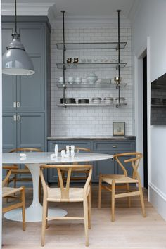 Shaker-ish grey cabinets, white oak floor, backsplash, metal/glass shelves?