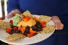 """Phase 3: Nachos! Turn our Nacho Cheesy Dip into a super Super Bowl snack, with chili, guac and FMD """"sour cream."""""""