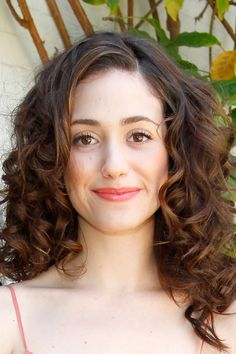 14 Seriously Cute Hairstyles for Curly Hair: Beauty: glamour.com  like Emmy Rossum's hairstyle? Gently tease your curls. Or fake spirals with a skinny curling iron,