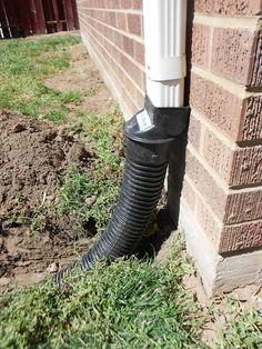 How to Bury a Gutter Downspout - TwoFeetFirst
