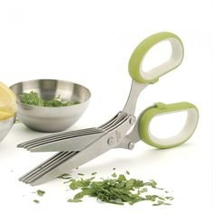 Handy Little Eco-Friendly Herb Scissors. Omg I have these and they're supposed to be paper slicing scissors but this is genius. How have I never thought to use them like this?!