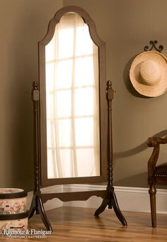 Bring some high style to a bedroom with this Kimberly cheval mirror. Its turned spindle frame, scrolled top edge and cherry finish offer a simple, classic look. It's the perfect gift for any mom out there.