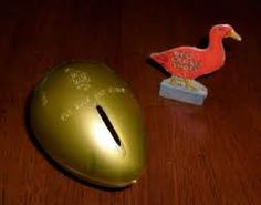 The Red Goose Shoes Golden Egg Bank-I remember pulling the neck of the big goose down to get the egg!