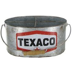 """Texaco Galvanized Bucket is divided into four sections. The metal silver bucket is lightly distressed with a vintage Texaco label. The handle is fitted with a round wooden grip piece. Give this useful yet decorative bucket to the nostalgic automobile lover in your life!        Dimensions:      Length: 9""""    Width: 6 1/2""""    Height: 5 1/2"""""""