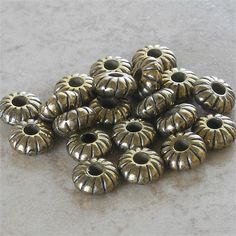 7x3.5mm Spacers Metalized Light Weight Acrylic Beads Small Roundel Spacers Ridged Antiqued Brass Metalized Beads   This is the only lot I have left.   Details:  Quantity: 25 pieces  Size: 7x3.5mm  Shape: Roundel, Rondelle, Donut  Hole size: Approximately 2.5mm   These beads/spacers are very well made. The hole can easily fit a 1.5mm leather or other similar size cord. Please see the third and fourth photos.   I will be happy to answer any questions.   Welcome to my shop. I am reorganizin...