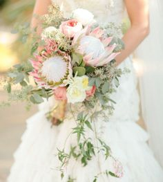 I can't believe the size of this wedding bouquet - so stunning! Glamorous Palm Springs Wedding: Meg + Scott - Protea Wedding Bouquet